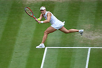 8th July 2021, Wimbledon, SW London, England; 2021 Wimbledon Championships, quarterfinals; Angelique Kerber (Ger) returns to Ashleigh Barty (Aus)