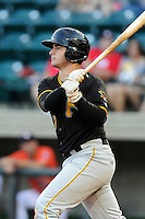 Catcher Daniel Arribas (23) of the Bristol Pirates bats in a game against the Greeneville Astros on Friday, July 25, 2014, at Pioneer Park in Greeneville, Tennessee. Greeneville won, 9-4. (Tom Priddy/Four Seam Images)