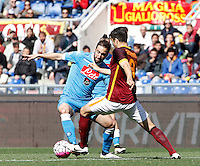 Calcio, Serie A: Roma vs Napoli. Roma, stadio Olimpico, 25 aprile 2016.<br /> Napoli's Gonzalo Higuain, left, is challenged by Roma's Ervin Zukanovic during the Italian Serie A football match between Roma and Napoli at Rome's Olympic stadium, 25 April 2016. <br /> UPDATE IMAGES PRESS/Isabella Bonotto