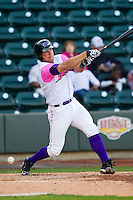 Kevan Smith (24) of the Winston-Salem Dash follows through on his swing against the Wilmington Blue Rocks at BB&T Ballpark on April 20, 2013 in Winston-Salem, North Carolina.  The Dash defeated the Blue Rocks 4-2 in game one of a double-header.  (Brian Westerholt/Four Seam Images)