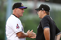Akron Aeros Chris Tremie #26 explains his point to umpire John Cunningham during a game against the Trenton Thunder at Canal Park on July 26, 2011 in Akron, Ohio.  Trenton defeated Akron 4-3.  (Mike Janes/Four Seam Images)