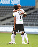 17th October 2020; Liberty Stadium, Swansea, Glamorgan, Wales; English Football League Championship Football, Swansea City versus Huddersfield Town; Andre Ayew and Korey Smith of Swansea City celebrate the penalty which made it 1-1 in the 33rd minute
