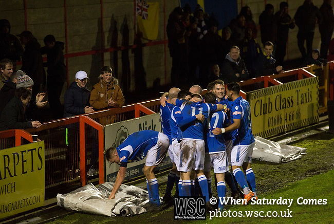 Witton Albion 1 Warrington Town 2, 26/12/2017. Wincham Park, Northern Premier League. Warrington Town players celebrating substitute Tony Gray's winning goal in second half stoppage time against Witton Albion at Wincham Park, during their Northern Premier League premier division fixture. Formed in 1887, the home team have played at their current ground since 1989 having relocated from the Central Ground in Northwich. With both team chasing play-off spots, the visitors emerged with a 2-1 victory, watched by a crowd of 503. Photo by Colin McPherson.