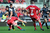 Sam Cross of Ospreys is tackled by Ed Kennedy of Scarlets during the Guinness Pro14 Round 6 match between Scarlets and Ospreys at the Parc Y Scarlets in Llanelli, Wales, UK. October 06, 2018