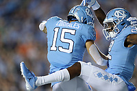 CHAPEL HILL, NC - SEPTEMBER 07: Dyami Brown #2 of the University of North Carolina celebrates his touchdown with Beau Corrales #15 during a game between University of Miami and University of North Carolina at Kenan Memorial Stadium on September 07, 2019 in Chapel Hill, North Carolina.