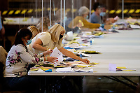 Pictured: A lady counts papers during the Swansea West and South West Wales Regional Election Count at Brangwyn Hall in Swansea, Wales, UK. Friday 07 May 2020