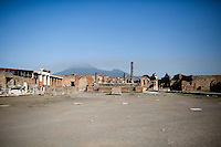 Mount Vesuvius looms over the forum on Friday, Sept. 18, 2015, in Pompeii, Italy. The city of Pompeii was destroyed when the nearby volcano erupted on August 24, AD 79. The town and its residents were buried and forgotten until the ruins were discovered and eventually excavated hundreds of years later. The ruins are one of Italy's top tourist attractions today. (Photo by James Brosher)