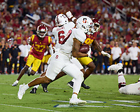 LOS ANGELES, CA - SEPTEMBER 11: Austin Jones #20 of the Stanford Cardinal runs with the ball during a game between University of Southern California and Stanford Football at Los Angeles Memorial Coliseum on September 11, 2021 in Los Angeles, California.