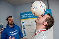 Friday 10 February 2017<br /> Pictured: Customer service advisor Michael Muriel balances a ball on his head <br /> Re:Welsh Government Dementia Risk Prevention Roadshow at the BT building, Swansea, Wales, UK