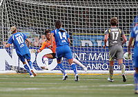 Karina LeBlanc #23 of the Philadelphia Independence is beaten by a penalty kick by Kelly Smith #10 of the Boston Breakers during a WPS match at John A. Farrell Stadium on August 29 2010, in West Chester, PA. Breakers won 2-1.