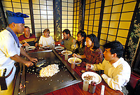 Chef prepares meal at customers' table at Shogun's, a Japanese restaurant in Little Rock, AR. Little Rock, Arkansas.