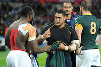 07 October 2015: Tendai Mtawarira of South Africa (left) and Oli Kilifi of USA swap shirts as Samu Manoa of USA and Duane Vermeulen of South Africa chat after Match 31 of the Rugby World Cup 2015 between South Africa and USA - Queen Elizabeth Olympic Park, London, England (Photo by Rob Munro/CSM)
