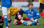 Partick Thistle v St Johnstone.....14.03.15<br /> Murray Davidson tangles with Stuart Bannigan<br /> Picture by Graeme Hart.<br /> Copyright Perthshire Picture Agency<br /> Tel: 01738 623350  Mobile: 07990 594431