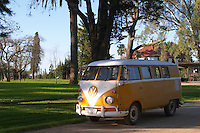 An old Volkswagen split screen 1960's camper van car painted white and yellow in the garden at the winery Bodega Juanico Familia Deicas Winery, Juanico, Canelones, Uruguay, South America