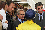 11/09/2011, trainer André Fabre (middle), listening to Meandre's jockey, Maxime Guyon, after the race Qatar Prix Niel, with owner Edouard de Rothschild (right) and his son David de Rothschild (left)