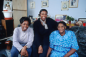 Olga Smith and her two daughters, tenants of resident-controlled Walterton and Elgin Community Homes, in their flat on Walterton Estate, North Paddington, London.