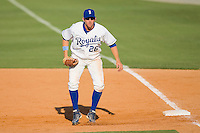 First baseman Geoff Baldwin #26 of the Burlington Royals on defense against the Kernersville Bulldogs in an exhibition game at Burlington Athletic Stadium June20, 2010, in Burlington, North Carolina.  Photo by Brian Westerholt / Four Seam Images
