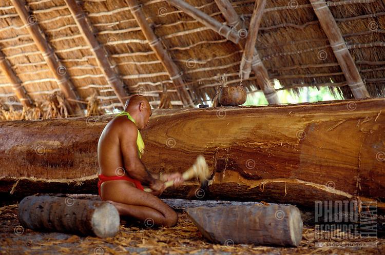 EDITORIAL ONLY. Demonstration of canoe building at Pu'uhonua o Honaunau National Park, (City of refuge) South Kona, Big Island