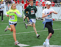 Runners and walkers finish the race at Camp Randall Stadium during the Crazylegs Classic on Saturday, 4/24/10, in Madison, Wisconsin