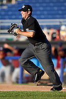 Umpire Donnie Smith gets in position during a game between the Mahoning Valley Scrappers and Batavia Muckdogs on June 24, 2015 at Dwyer Stadium in Batavia, New York.  Batavia defeated Mahoning Valley 1-0 as three Muckdogs pitchers combined to throw a perfect game.  (Mike Janes/Four Seam Images)