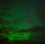 Northern lights between the clouds on the Snaefellsnes peninsula on the west coast of Iceland. (Bob Gathany)
