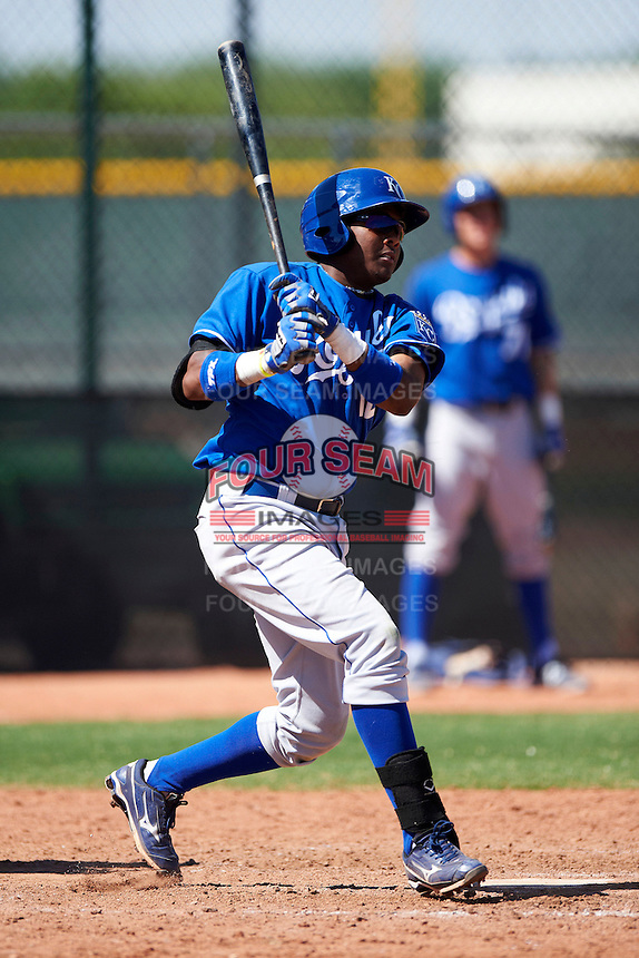 Kansas City Royals minor league infielder Daniel Mateo #12 at bat during an instructional league game against the Texas Rangers at the Surprise Stadium Minor League Complex on October 10, 2012 in Surprise, Arizona.  (Mike Janes/Four Seam Images)