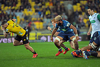 TJ Perenara steals the ball from the base of the Blues' scrum during the Super Rugby Aotearoa match between the Hurricanes and Blues at Sky Stadium in Wellington, New Zealand on Saturday, 18 July 2020. Photo: Dave Lintott / lintottphoto.co.nz