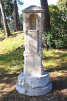 A stone altar in the garden with a story about three good saints Domaine de la Tour du Bon Le Castellet Bandol Var Cote d'Azur France