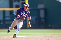TCU Horned Frogs outfielder Austen Wade (8) runs to third base against the Texas Tech Red Raiders in Game 3 of the NCAA College World Series on June 19, 2016 at TD Ameritrade Park in Omaha, Nebraska. TCU defeated Texas Tech 5-3. (Andrew Woolley/Four Seam Images)