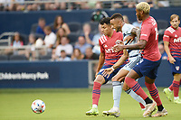 KANSAS CITY, KS - JULY 31: Khiry Shelton #11 Sporting KC watched by Edwin Cerrillo #6 and Nkosi Tafari #14 FC Dallas during a game between FC Dallas and Sporting Kansas City at Children's Mercy Park on July 31, 2021 in Kansas City, Kansas.