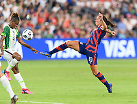 AUSTIN, TX - JUNE 16: Carli Lloyd #10 of the United States kicks the ball towards the Nigerian goal during a game between Nigeria and USWNT at Q2 Stadium on June 16, 2021 in Austin, Texas.
