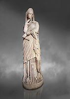 Roman statue of Nemesis goddess of  retribution.Marble. Perge. 2nd century AD. Inv no 6.29.81 .Antalya Archaeology Museum; Turkey. Against a grey background