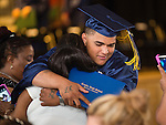 WATERBURY, CT- 8 June 2016-060816EC01-  Angel Luis Rivera hugs his mother Ramona Wednesday after he graduated from The State Street School in Waterbury. Five seniors received their diplomas inside the Police Activity League building. Erin Covey Republican-American
