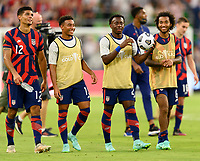 AUSTIN, TX - JULY 29: Miles Robinson #12, Jonathan Lewis #15, George Bello #21, and Nicholas Gioacchini #8 of the United States applauds the fans after a game between Qatar and USMNT at Q2 Stadium on July 29, 2021 in Austin, Texas.