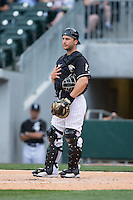 Charlotte Knights catcher George Kottaras (20) on defense against the Louisville Bats at BB&T BallPark on May 12, 2015 in Charlotte, North Carolina.  The Knights defeated the Bats 4-0.  (Brian Westerholt/Four Seam Images)