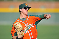 Left fielder Casey Soltis (35) of the Greensboro Grasshoppers warms up before a game against the Greenville Drive on Thursday, July 14, 2016, at Fluor Field at the West End in Greenville, South Carolina. (Tom Priddy/Four Seam Images)