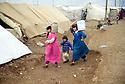 Turkey 1991.For Kurdish women,water duty in a camp near Mardin