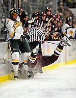 10 January 2009: University of Vermont Catamount forward Viktor Stalberg, a Junior from Gothenburg, Sweden, keeps clear of a falling Boston College Eagles' defenseman Nick Petrecki, a Sophomore from Clifton Park, NY, during the second game of a weekend series at Gutterson Fieldhouse in Burlington, Vermont. The Catamounts rallied from an early 2-0 deficit to defeat the visiting Eagles 4-2. Mandatory Photo Credit: Ed Wolfstein Photo