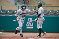 Dartmouth Big Green right fielder Matt Feinstein (23) fist bumps Blake Crossing (13) during a game against the USF Bulls on March 17, 2019 at USF Baseball Stadium in Tampa, Florida.  USF defeated Dartmouth 4-1.  (Mike Janes/Four Seam Images)