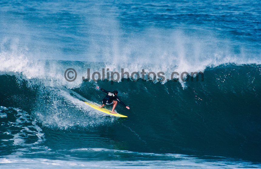 Wayne Lynch (AUS) surfing Mundaka rivermouth during an epic swell in November 1989. Mundaka, Basque Country, Spain. Photo: joliphotos.com