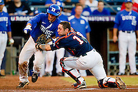 Virginia Cavaliers catcher Nate Irving #18 tags out Mike Rosenfeld #15 of the Duke Blue Devils as he tries to score in the bottom of the 5th inning at Durham Bulls Athletic Park on April 20, 2012 in Durham, North Carolina.  (Brian Westerholt/Four Seam Images)