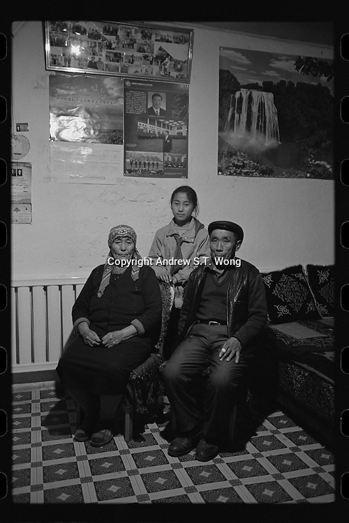 Jeminay County, Xinjiang Uygur Autonomous Region, China - A young student and grandparents seen at home after class, October 2019.