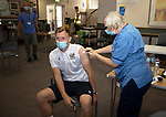 St Johnstone v Fleetwood Town…24.07.21  McDiarmid Park<br />Liam Craig pictured receiving his Covid-19 vaccination from nurse Fiona Little<br />Picture by Graeme Hart.<br />Copyright Perthshire Picture Agency<br />Tel: 01738 623350  Mobile: 07990 594431