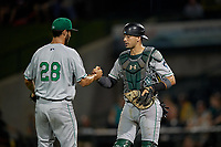 Clinton LumberKings pitcher Nathan Alexander (28) and catcher Will Banfield (11) shake hands after closing out a Midwest League game against the Great Lakes Loons on July 19, 2019 at Dow Diamond in Midland, Michigan.  Clinton defeated Great Lakes 3-2.  (Mike Janes/Four Seam Images)