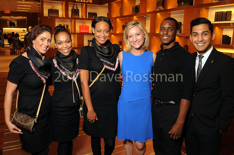 Emily Paull and Louis Vuitton employees at an evening honoring The Houston Symphony Young Associates Council at the Louis Vuitton store in the Galleria Thursday August 15, 2013.(Dave Rossman photo)