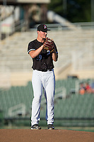 Kannapolis Intimidators starting pitcher Chris Comito (39) looks to his catcher for the sign against the Greenville Drive at Intimidators Stadium on June 8, 2016 in Kannapolis, North Carolina.  The Intimidators defeated the Drive 3-2.  (Brian Westerholt/Four Seam Images)