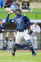 UNCG Spartans catcher Cambric Moye (30) makes a throw to first base against the Georgia Southern Eagles at UNCG Baseball Stadium on March 29, 2013 in Greensboro, North Carolina.  The Spartans defeated the Eagles 5-4.  (Brian Westerholt/Four Seam Images)