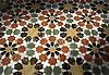 Granada, a stone waterjet mosaic in Emperador Dark, Verde Luna, Rojo Alicante, Calacatta Tia and Giallo Reale polished. Paul Schatz for New Ravenna Mosaics.