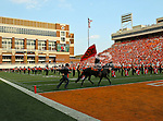 The Oklahoma State Cowboys marching band and Bullet in action during the game between the Louisiana-Lafayette Ragin Cajuns and the Oklahoma State Cowboys at the Boone Pickens Stadium in Stillwater, OK. Oklahoma State defeats Louisiana-Lafayette 61 to 34.