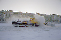 St Petersburg, Russia, January 2003..An ice-beaker struggles through the frozen River Neva in temperatures of -30C with the Hermitage Museum behind..